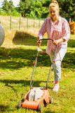 Gardening. Mowing lawn with lawnmower Royalty Free Stock Photo