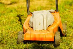 Gardening. Mowing lawn with lawnmower Royalty Free Stock Photography