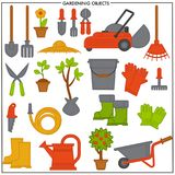 Gardening objects set composed of convenient metal tools. Electric lawn mower, iron bucket, rubber boots, compact cart, big spade and rake, sharp secateurs and Royalty Free Stock Photo
