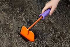 Gardening with orange chopper Royalty Free Stock Photos