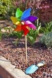 Gardening, Pinwheel. Pinwheel and scoop in the garden Royalty Free Stock Images