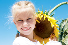 Gardening, planting concept - portrait of lovely girl with sunfl Royalty Free Stock Image