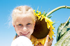 Gardening, planting concept - portrait of lovely girl with sunfl Stock Photos