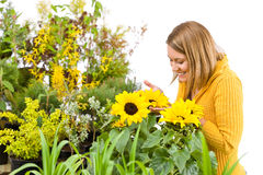 Gardening - portrait of woman with sunflowers Stock Photography