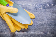 Gardening protective gloves hand spade on wooden board agricultu Stock Image