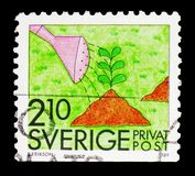 Gardening, Rebate stamps - Summer Activities serie, circa 1989. MOSCOW, RUSSIA - FEBRUARY 10, 2019: A stamp printed in Sweden shows Gardening, Rebate stamps royalty free stock photo