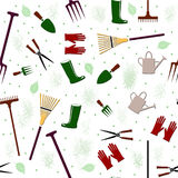 Gardening Seamless Pattern. A seamless pattern of garden tools including rakes gloves boots pitchfork shears and watering cans Stock Photo