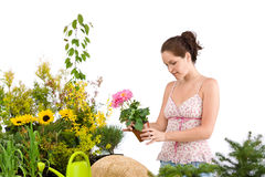 Gardening - smiling woman holding flower pot Stock Photography