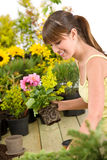 Gardening - smiling woman holding flower pot Royalty Free Stock Photo