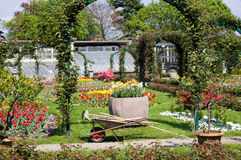 Gardening in spring time. Gardening tools in a marvellous garden full of tulips near the Lago Maggiore, Italy Stock Photography