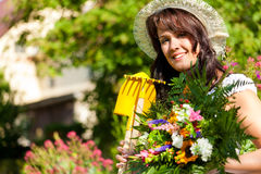 Gardening in summer - woman with flowers Stock Image