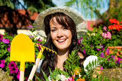 Gardening in summer - woman with flowers Royalty Free Stock Photo