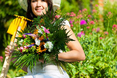 Gardening in summer - woman with flowers Stock Photography