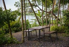 Gardening table with chair near a river and Tree for relaxing. Royalty Free Stock Photo