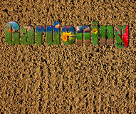 Gardening text on soil and grass background Stock Images