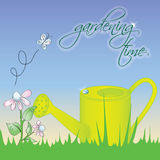 Gardening time. Green watering can on the grass - vector illustration Stock Images