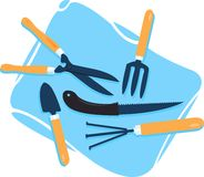 Gardening tools. Spread on a blue coloured bag Stock Photography