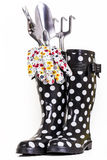 Gardening Tools. Gloves and rubber boots ready for some garden work Royalty Free Stock Images