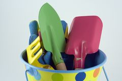 Gardening Tools. Bucket, spade, trowel, rake and gloves Royalty Free Stock Images