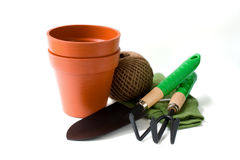 Gardening tools. With pots, trowel and gloves Stock Image