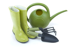 Gardening tools. Gardening boots and tools on a white background Stock Photo