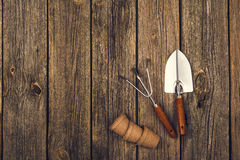 Gardening tools and accessories on wooden background. Top view Stock Photography