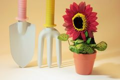 Gardening tools and Artificial Potplant Stock Image