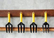 Gardening tools, black iron rake with plastic handle Stock Image