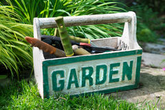 Genial Gardening Tools. A Box With The Word Garden On It Filled With Gardening Tool  Sitting