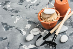Gardening tools and clay terracotta flower pots Stock Photography