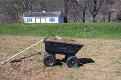 Gardening tools on dirt and grasses in yard cart Stock Photos