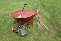 Gardening Tools and Equipment. Various standard gardening tools on a grass lawn stock photos