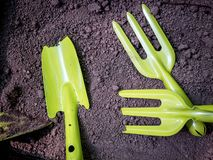 Gardening tools on fertile soil texture background royalty free stock photo