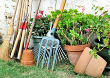 Gardening tools and flowerpots Stock Photos