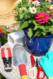 Gardening tools and flowers. It is gardening tools and flowerpot in spring Royalty Free Stock Images