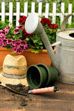 Gardening tools. Flowers and straw hat Stock Photo