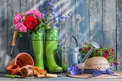 Gardening tools and flowers on the terrace Stock Photos