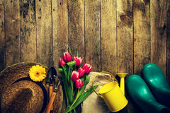 Gardening tools, flowers, watering can, rubber boots and straw h Royalty Free Stock Photography