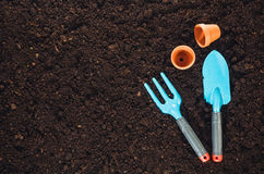 Gardening tools on garden soil texture background top view Stock Image