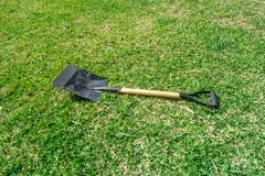 Gardening tools on grass green background stock photos