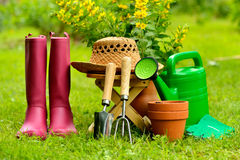 Gardening tools on green background and grass Royalty Free Stock Photography