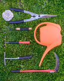Gardening tools on green grass in the garden Royalty Free Stock Image