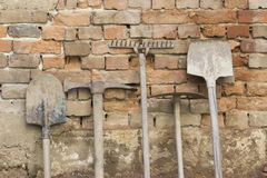 Gardening tools. Gardening hand tools on old brick wall Stock Photos