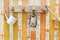 Gardening tools hanging on wooden wall Royalty Free Stock Photo