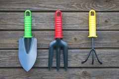 Gardening Tools Hanging On Wooden Wall Of Shed. Royalty Free Stock Photography