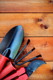 Gardening tools and objects on old wooden background Royalty Free Stock Photography