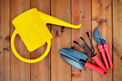 Gardening tools and objects on old wooden background Royalty Free Stock Photos