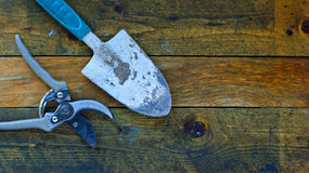 Gardening tools on old wooden table Royalty Free Stock Photo