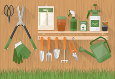 Gardening Tools On A Wooden Shelf Stock Image