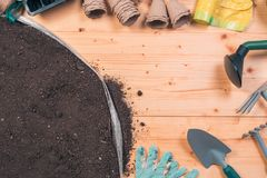 Gardening tools on potting soil, top view royalty free stock photos